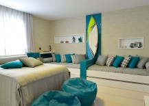 Plush-daybeds-and-surfboard-on-the-wall-for-the-coastal-style-bedroom-217x155