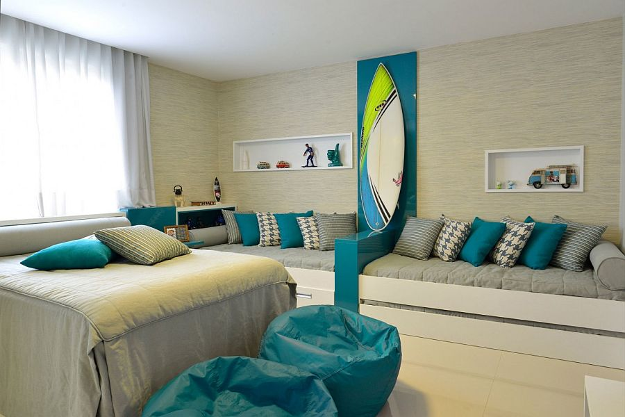 Plush daybeds and surfboard on the wall for the coastal style bedroom