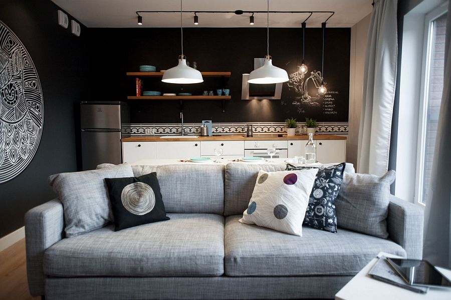 Plush gray couch in the living room with black walls