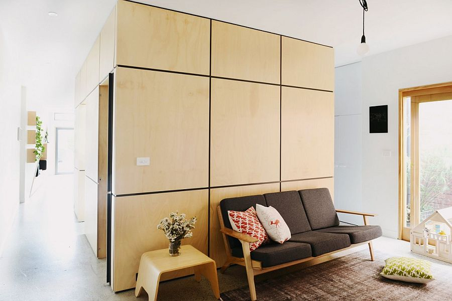 Ply wood clad pod contains the bathroom, powder room and pantry