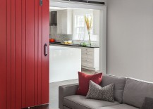 Posh living room in gray with a healthy dose of red