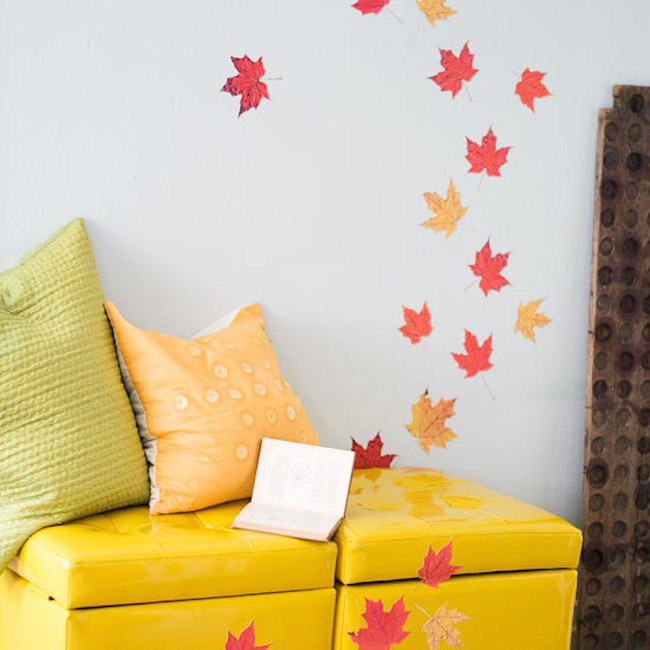 Pressed leaves attached to wall and furniture