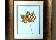 Pressed leaves painted in gold 217x155 8 Creative DIY Project Ideas for Using Fall Leaves as Seasonal Wall Art