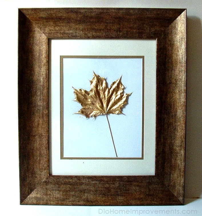 Pressed leaves painted in gold