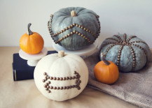 Pumpkins decoarted with furniture nails