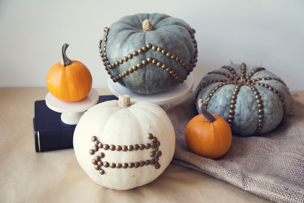 Pumpkins decorated with furniture nails
