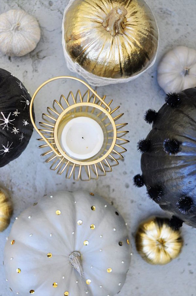 Pumpkins painted in black and white, decorated with gold beads