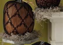 Pumpkins with black lace displayed on platforms 217x155 8 Easy and Chic Ways to Dress Up Your Pumpkins for Halloween