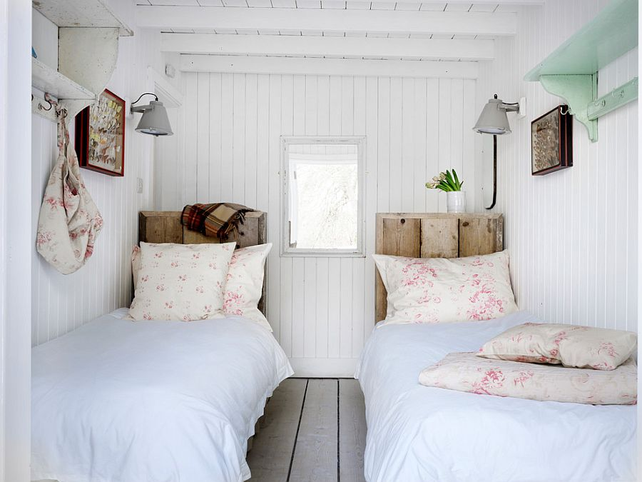 Reclaimed wood headboards add visual and textural contrast [Design: Cabbages & Roses]
