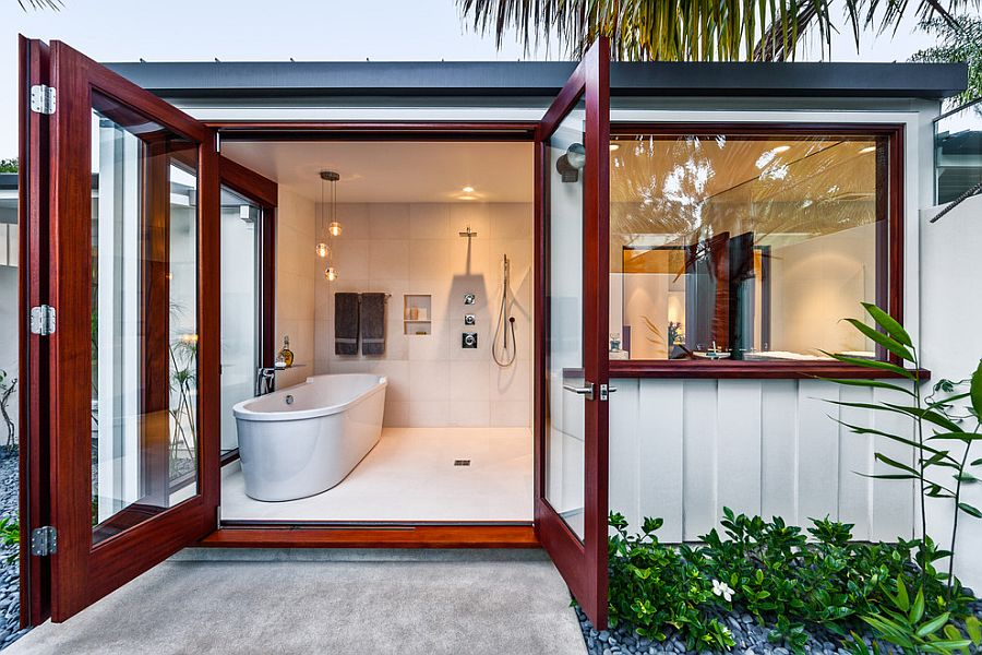 Relaxing bathroom with standalone bathtub opens up into the landscape outside
