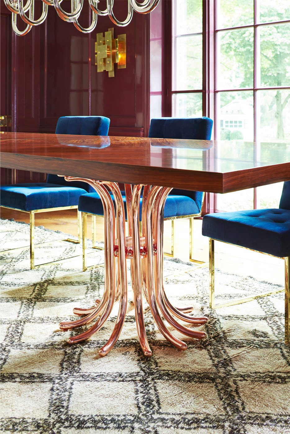 Rosewood table with a rose gold base from Jonathan Adler