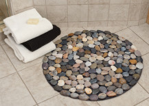 Round bath mat with different colored pebbles 217x155 7 Bath Mat Ideas to Make Your Bathroom Feel More Like a Spa