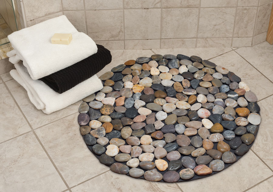 Round bath mat with different colored pebbles