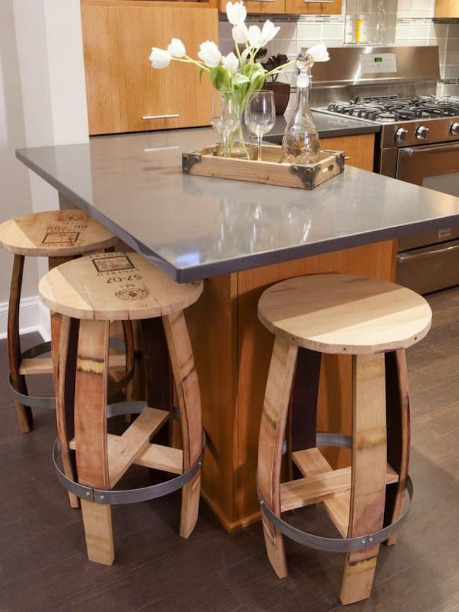 Rustic bar stools made from old wine barrels