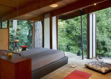 Rustic bedroom with amazing forest views is Zen-conjuring in its own unique way