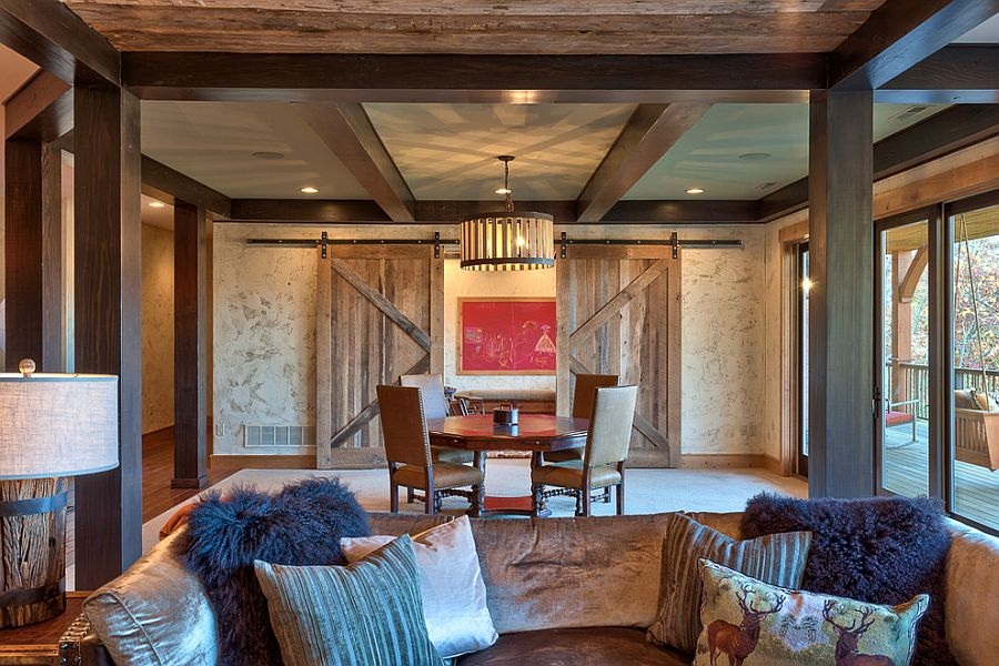 Rustic living room with sliding barn doors [Design: Glennwood Custom Builders]