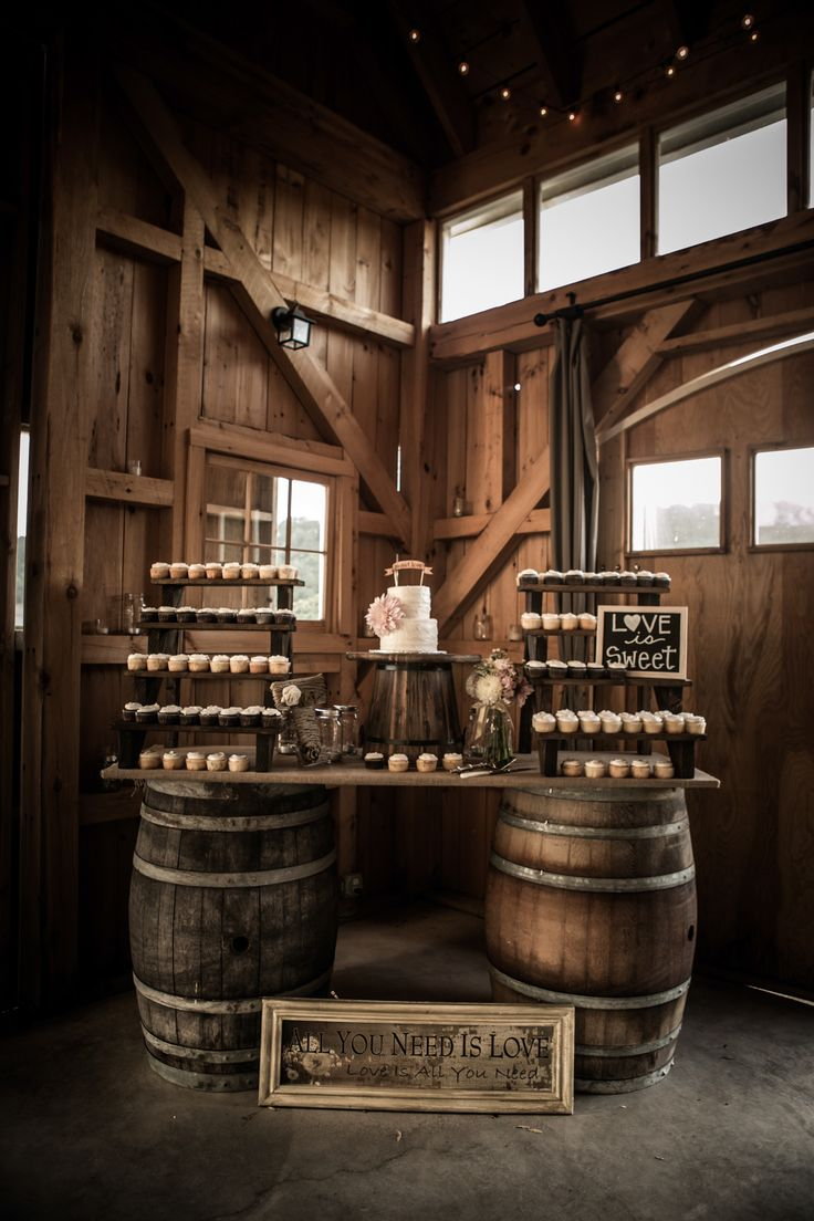 Rustic wedding table display using wine barrels