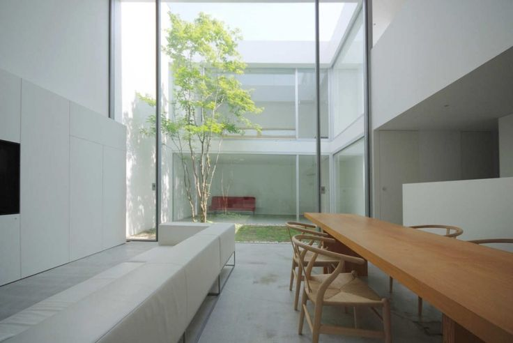 Seating areas in a building separated by a small courtyard