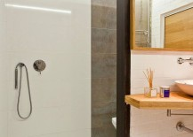 Shower-area-of-the-small-bathroom-in-tile-and-concrete-217x155