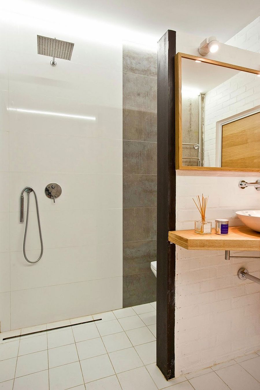 Shower area of the small bathroom in tile and concrete