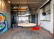 Simple decor and colorful art work add elegance to the industrial setting