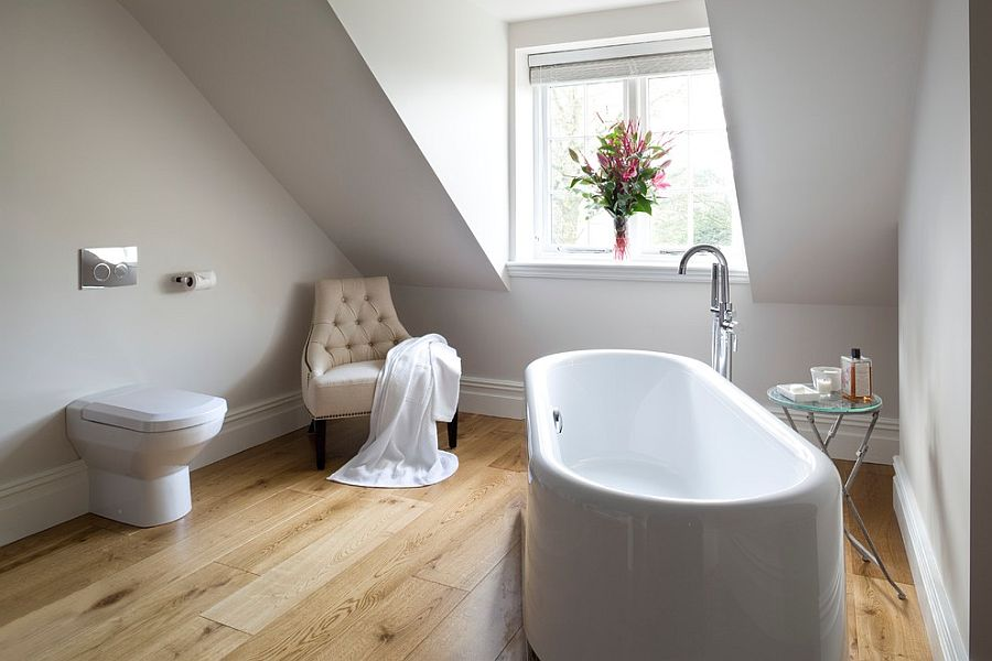 Simple side table with glass top next to the white standalone bathtub [Design: James Hargreaves Bathrooms]