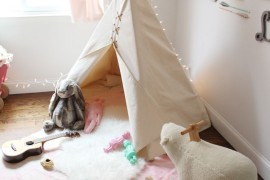 Simple white teepee with lots of toys nearby to play with 15 Whimsical Teepee Reading Nooks for Kids 15 Whimsical Teepee Reading Nooks for Kids Simple white teepee with lots of toys nearby to play with