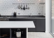 Simplicity-of-lighting-and-pattern-of-the-backsplash-hold-your-attention-in-this-Scandinavian-kitchen-217x155