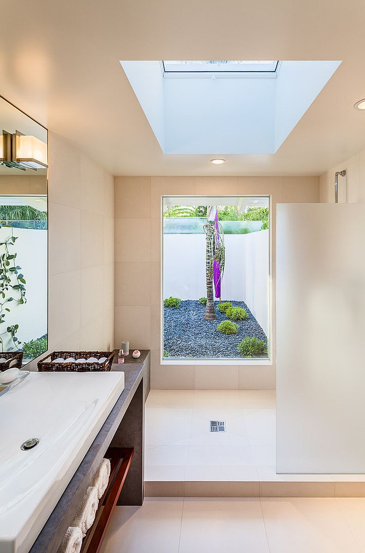Skylight adds to the flood of natural light inside the breezy bathroom