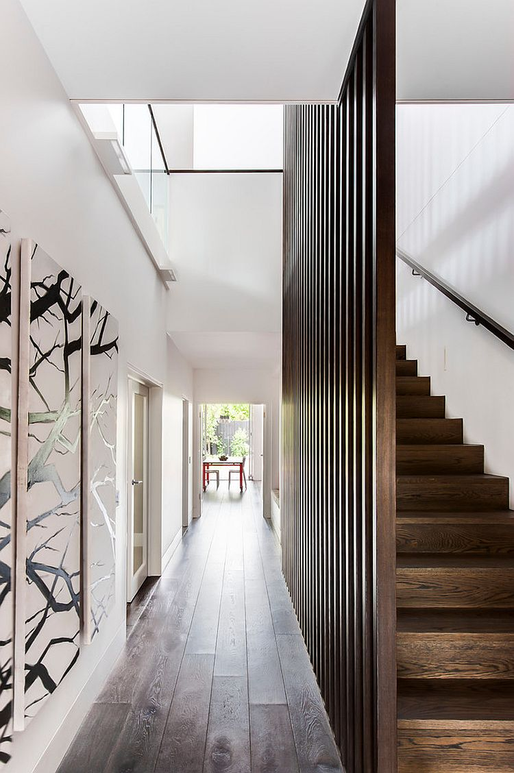 Sleek entry of the Melbourne home with gallery style walls