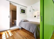 Sleeping-nook-and-guest-room-on-top-level-with-sliding-green-doors-217x155