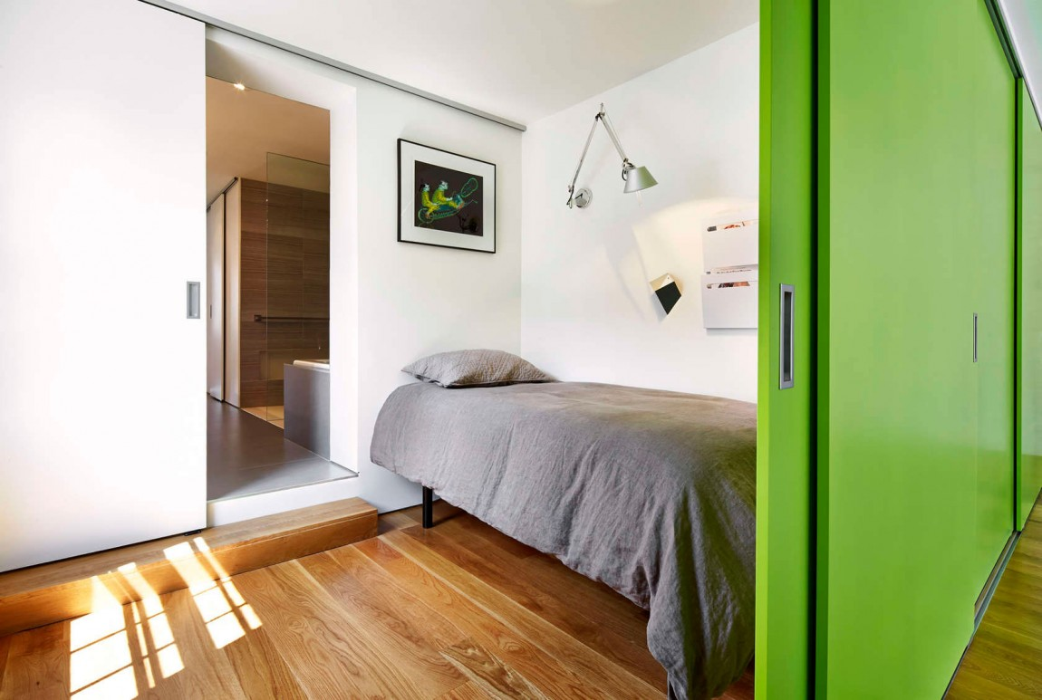 Sleeping nook and guest room on top level with sliding green doors