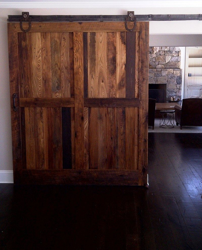Sliding barn doors made from reclaimed chestnut lumber for living space [From: Reclaimed Lumber Products]