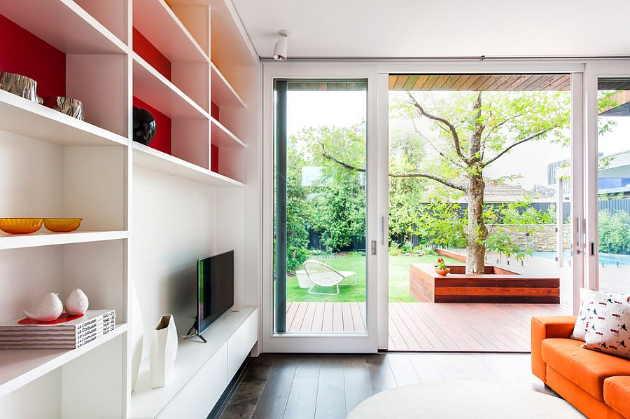 Sliding glass doors connect the kids' room with the lavish deck outside