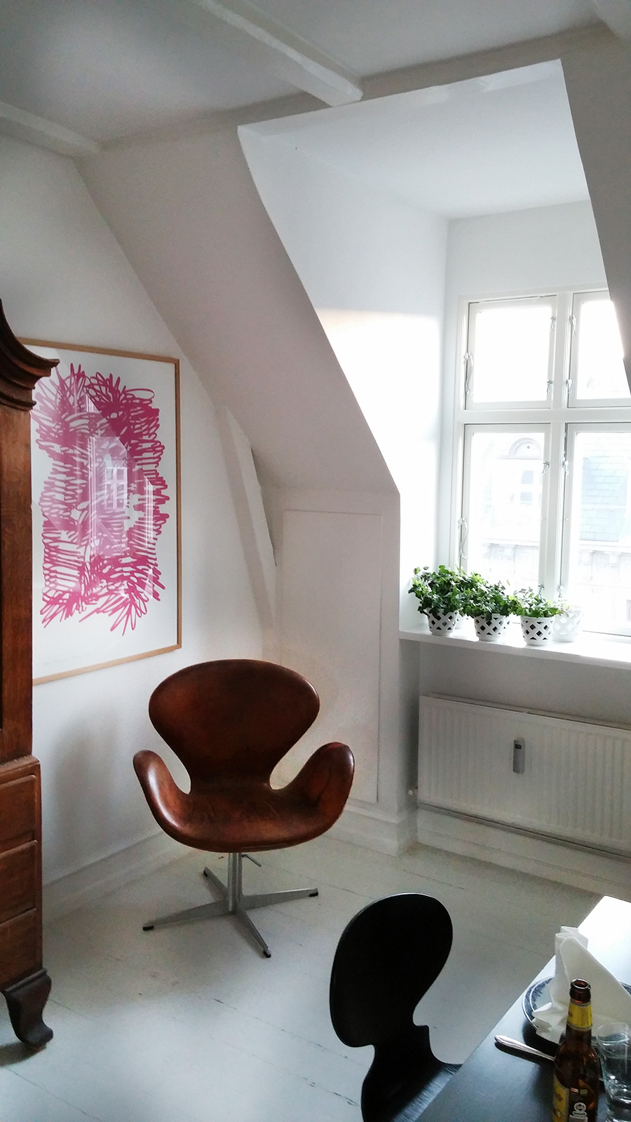 Small Sitting Area with Brown Chair and Window