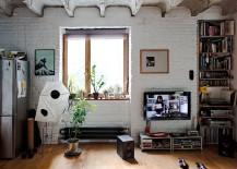 Small industrial living room of Bratislava Apartment with brick walls [Design: Gut Gut]
