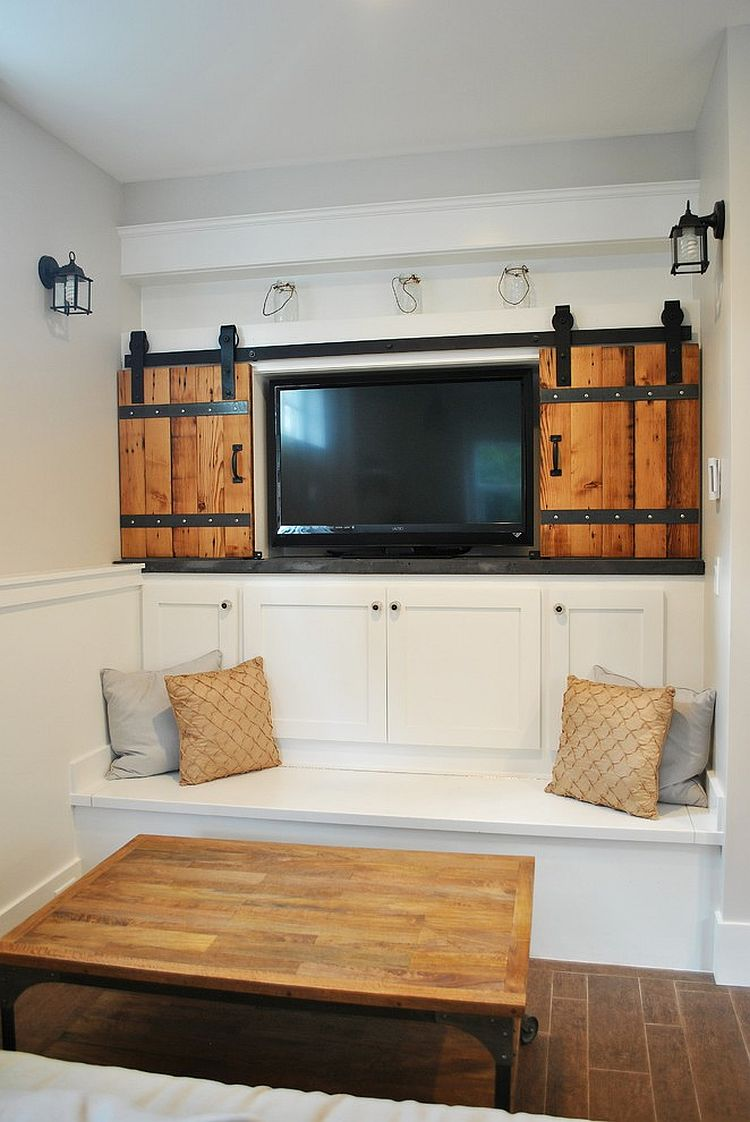 Small living room with sliding barn-style doors for the television nook [Design: 12th Ave Homes]