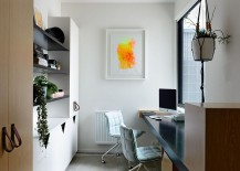 Small modern home office designw ith ample shelving space