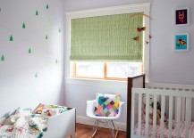 Small nursery design with baby bed and a crib