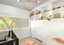 Small nursery idea in white with wallpapered ceiling and vintage lighting