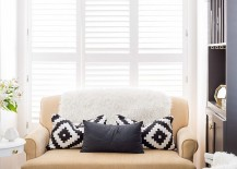 Small-sofa-in-pastel-hue-turns-out-to-be-the-focal-point-of-the-tiny-living-room-217x155