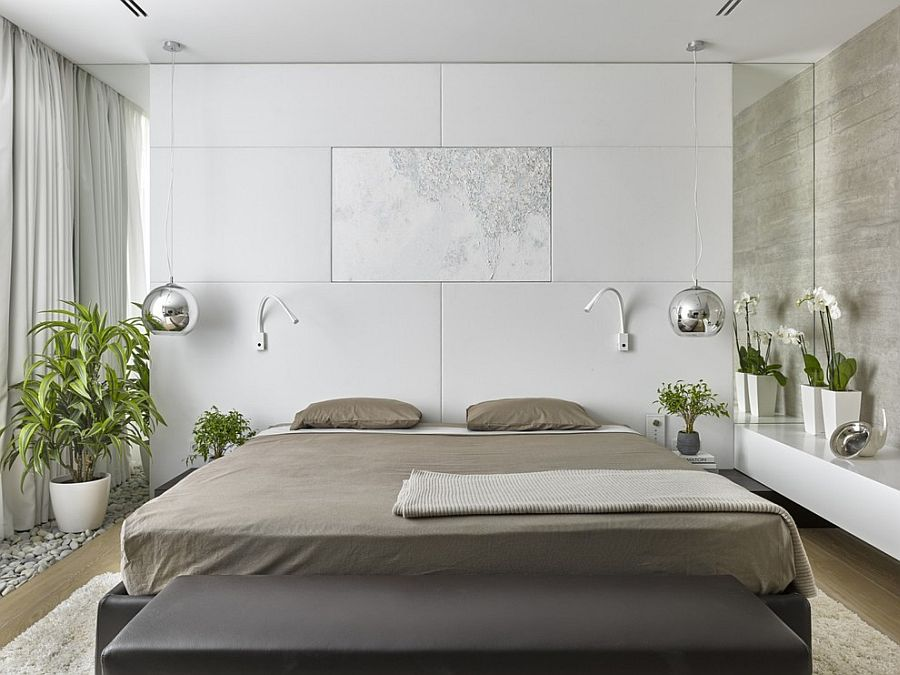 Soft white leather headboard wall, bedside pendants and greenery fashion a rejuvenating bedroom [Design: Alexandra Fedorova Office]