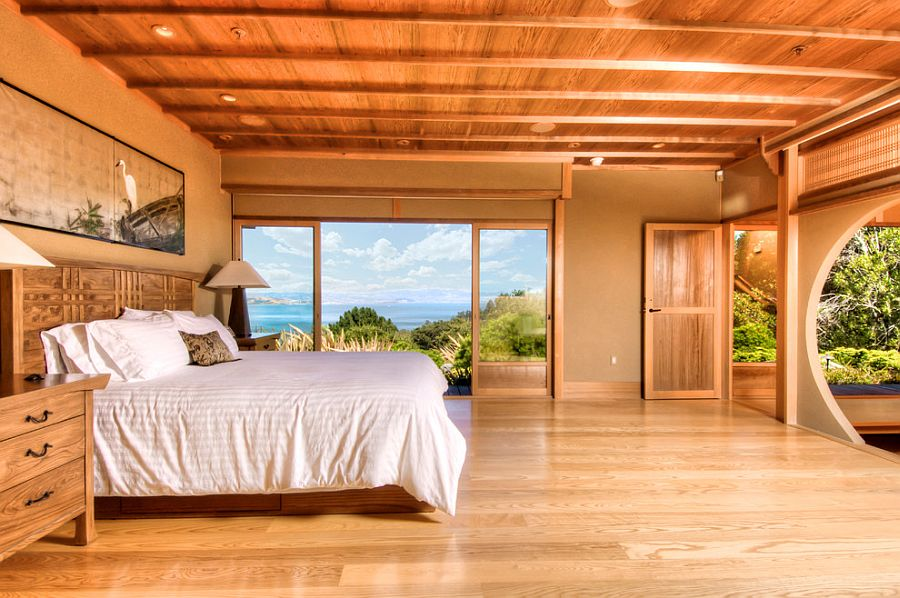 Soothing wooden tones and natural materials give the bedroom with a view a tranquil touch