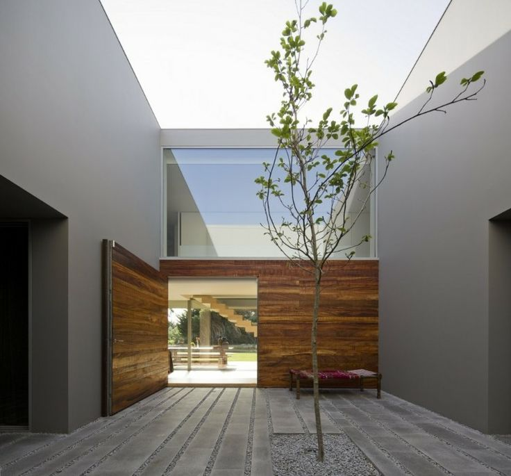 Square courtyard with a tree in a Portuguese building