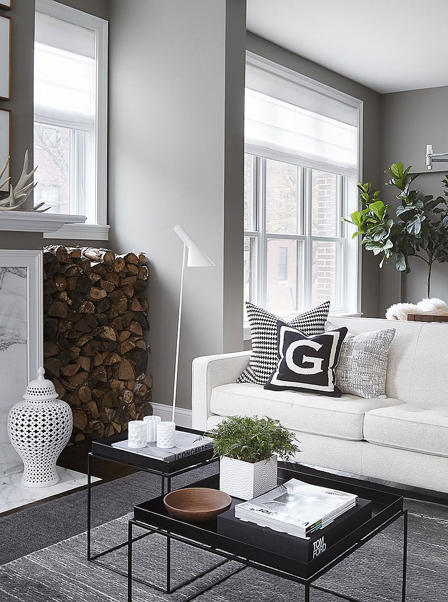 Stacked fireplace next to the fireplace adds textural beauty to the posh living room