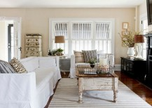 Stacked trucks, salvages coffee table and metal baskets for the shabby chic interior [Photography: Rikki Snyder]