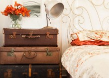 Stacked vintage suitcases serve both as bedside table and storage [Design: Twinkle and Whistle]