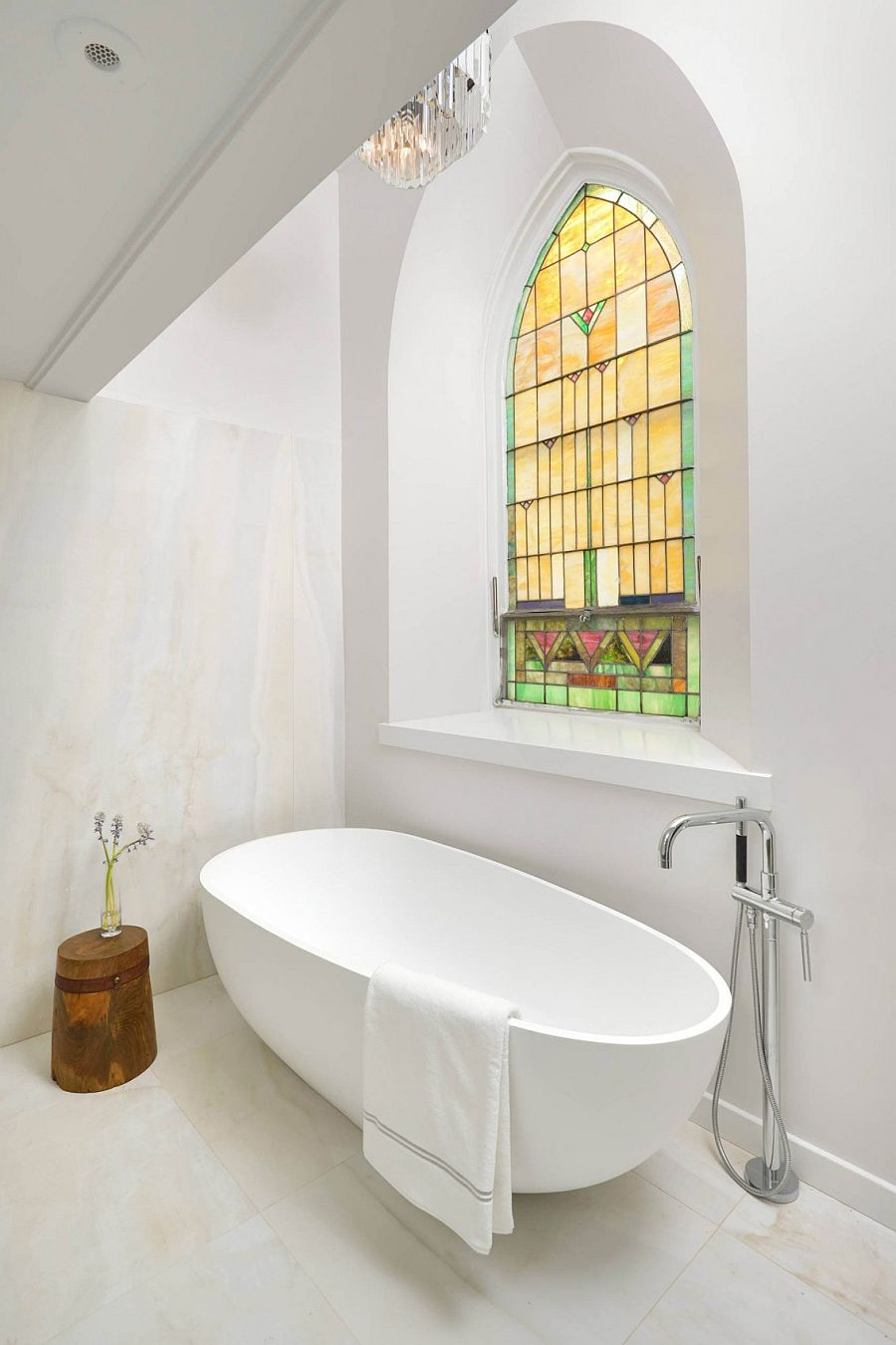Stained glass window makes its presence felt in the contemporary bathroom