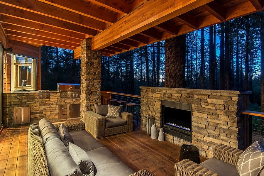 Stone and wood outdoor deck with barbecue zone and fireplace [Design: Jenifer Giudice]