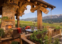Stone fireplace and a cozy sitting area for the rustic deck